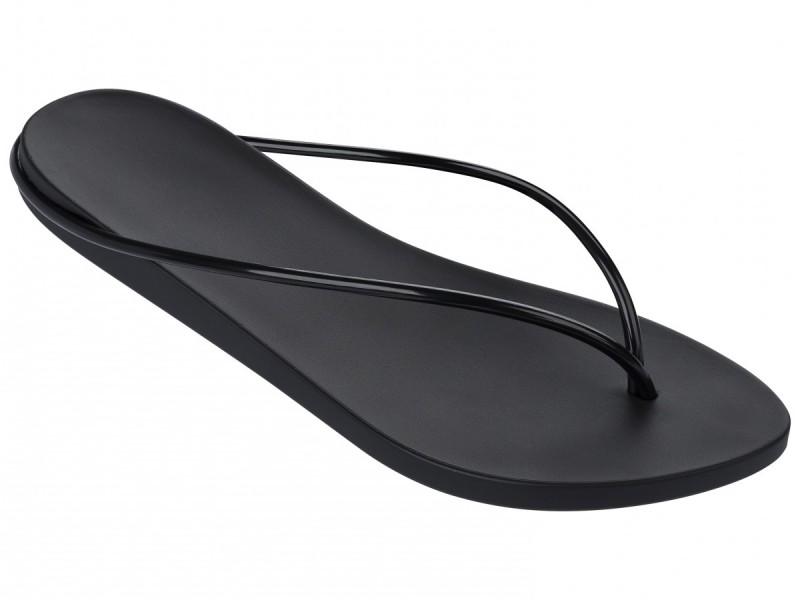 Schwarze Zehentrenner von Philipe Starck mit elegant schmalem Riemchen
